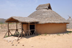 Reconstruction of Neolithic House. In the neolithic, the semi-subterranean mud  houses started appearing Stock Photography