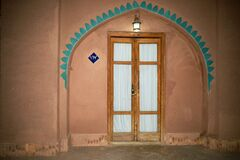 Free Reconstruction Of Old Arched Tile Decorations Around Doors And Windows, The Gouged Castle, Isfahan. Stock Photo - 189920140