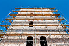 Reconstruction of old building. Old building during reconstruction. Wide angle shot Royalty Free Stock Image
