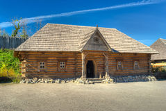 Reconstruction of old log house in outdoor museum Royalty Free Stock Image