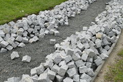 Reconstruction of a pack sidewalk with cobbles Stock Photography