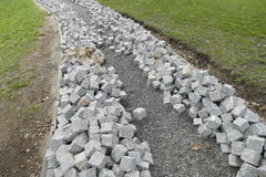Reconstruction of a pack sidewalk with cobbles Royalty Free Stock Images