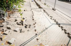 Reconstruction of the paving stones on the parking lot in the urban city street.  stock image