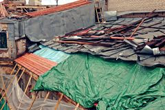 Reconstruction of the of the roof in the old town house. Tinted photo. Stock Image