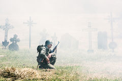 Reconstruction of the Second World War, german soldier squats an royalty free stock photos