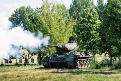Reconstruction of the Second World War, russian war tank shoots Royalty Free Stock Photo