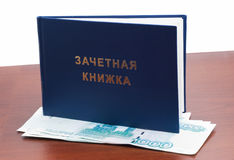 Record book with the money, paid education Royalty Free Stock Photos