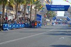 Record Breaking Marathon Runner. Vincent Yator winning and breaking the course record the Santa Pola half Marathon Royalty Free Stock Photography
