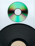 Record and CD. Close up of a cd and partial record over white Royalty Free Stock Images