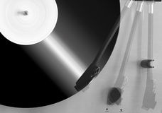 Record Deck. Multiple exposure of record deck with tone arm in three positions and vinyl LP revolving Stock Image
