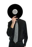 Record Head. Man in suit and tie holds up a record LP to his head Stock Images