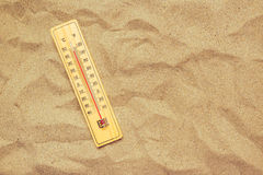 Record high temperatures, thermometer on warm desert sand Royalty Free Stock Photo