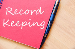 Record keeping write on notebook stock photos