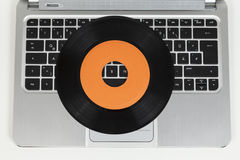 Record and laptop computer Royalty Free Stock Photography