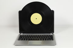 Record and laptop Stock Photos