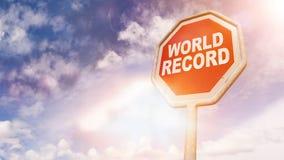 Record mondial, texte sur le poteau de signalisation rouge Photographie stock libre de droits