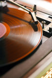 Record player. A record player is playing a vinyl record Royalty Free Stock Images