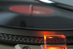 Record Player. A close look at a vinyl record player that is turned on with the needle approaching the record Stock Photography