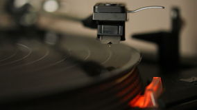 Record player. Close up HD movie of a record player playing a vinyl black record. The needle is being put onto the record