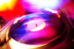Record player in club. Colorful and blurry Royalty Free Stock Photo