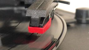 A record vinyl Player. A record player playing vinyl records