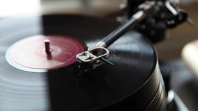 Record player playing vinyl. Retro vinyl turntable stylus close up stock video footage