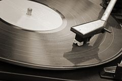 Record player. Record player stylus on a rotating disc, Picture of a vinyl record playing Royalty Free Stock Photo