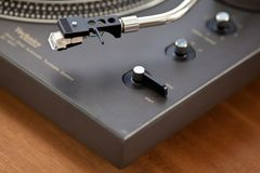 Record Player Tonearm Headshell Closeup. Vintage Record Player Tonearm Headshell and knobs Angled View Closeup Royalty Free Stock Image