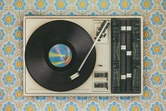 Record player on top of flower wallpaper Stock Photography