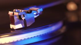 Record player turntable HD stock footage. A record player turntable with it`s stylus running along a vinyl record. Neon. Violet light stock video