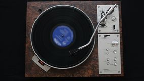 Top view of turntable and vinyl record. A record player turntable with it`s stylus running along a vinyl record stock video footage
