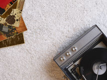 Record player and vinyl records on floor view from above Stock Image