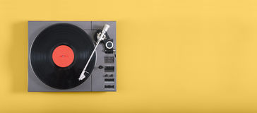 Record player. On yellow background Stock Photography