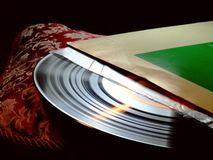 Record and Sleeve. A vinyl LP record partially removed from its cover Royalty Free Stock Photography