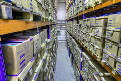 Record storage archives, document warehouse secure storage syste. St. Petersburg, Russia - December 3, 2013: Boxes of stored records in warehouse, secure Royalty Free Stock Photos