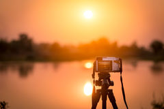 Record time-lapse video of the sunset Stock Image
