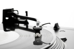 Record on turntable. A vinyl LP album on an old-fashioned record player turntable Stock Images