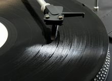 Record on turntable. 33 rpm record on a turntable Stock Photos