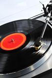 Record on turntable. Vinyl record spinning on turntable close up Stock Photos