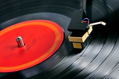 Record on turntable. Vinyl record spinning on turntable close up Royalty Free Stock Image