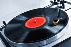 Record on turntable. Vinyl record spinning on turntable close up Royalty Free Stock Photos