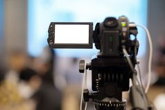 Record video in seminar. Closeup video camera recording in seminar room royalty free stock photo