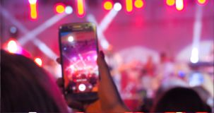 People use smart phones record video at music concert stock video footage