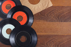 Record vinyl top view on wooden background Royalty Free Stock Image