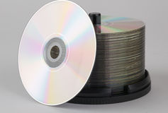 Recordable DVD's on a spindle. Isolated on a gray background Royalty Free Stock Image
