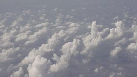 View on small clouds from airplane over rural areas of Thailand stock video