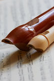 Recorder, flute, baroque. Recorder flute, sheet music, close up Royalty Free Stock Images