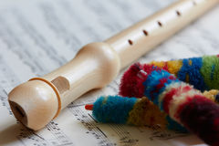 Recorder, flute. Recorder flute, sheet music, close up Royalty Free Stock Image