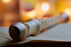 Recorder, flute. Recorder flute, sheet music, close up Royalty Free Stock Images