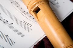 Recorder and music notes Stock Image